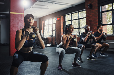 Buy stock photo Shot of a group of people working out together