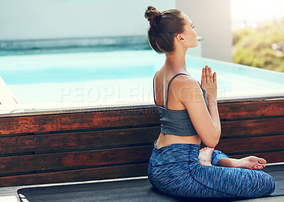 Buy stock photo Shot of a beautiful young woman practicing yoga outside