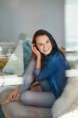 Buy stock photo Shot of an attractive young woman spending a relaxing day on the sofa at home