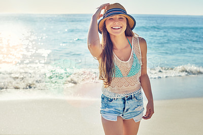 Buy stock photo Portrait of a beautiful young woman spending the day at the beach