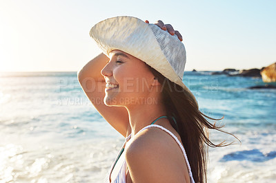 Buy stock photo Shot of a beautiful young woman spending her day outside
