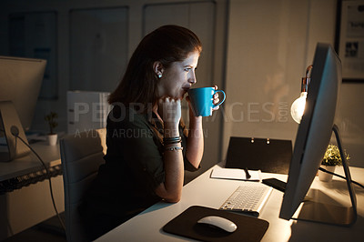 Buy stock photo Shot of a businesswoman working late on a computer in an office