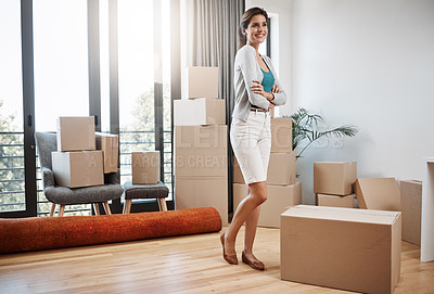 Buy stock photo Full length shot of an attractive young woman standing with her arms folded while moving into a new house
