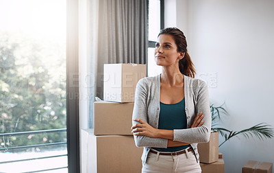 Buy stock photo Cropped shot of an attractive young woman standing in her new home while moving in
