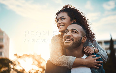Buy stock photo Shot of a young couple having fun together outdoors