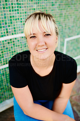 Buy stock photo Portrait of an attractive young woman spending the day outside