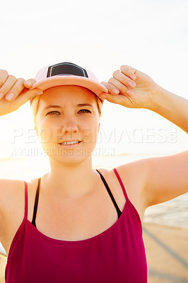 Buy stock photo Portrait of an attractive young woman working out on the promenade