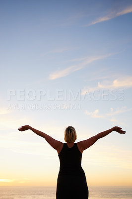 Buy stock photo Rearview shot of an unrecognizable woman at the beach