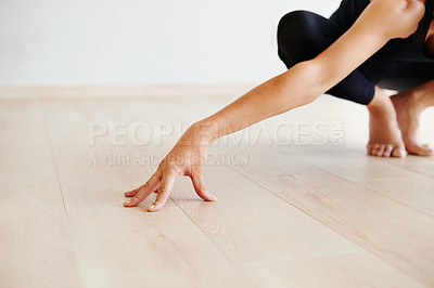 Buy stock photo Shot of an unrecognizable woman practicing yoga poses inside of a studio during the day
