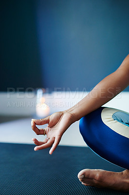 Buy stock photo Cropped shot of an unrecognizable woman practising yoga at home
