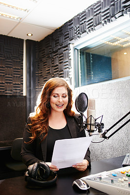 Buy stock photo Shot of a young woman working in a recording studio
