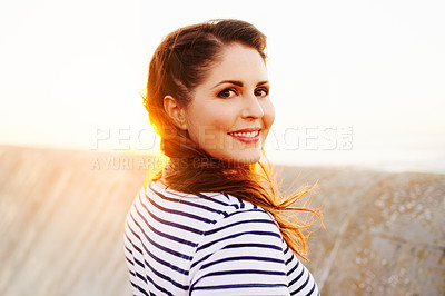 Buy stock photo Portrait of a beautiful young woman spending the day on the promenade at the beach