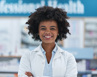 Buy stock photo Portrait of a young pharmacist working in a chemist