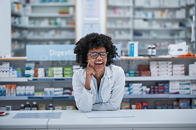 Buy stock photo Shot of a young pharmacist working in a chemist