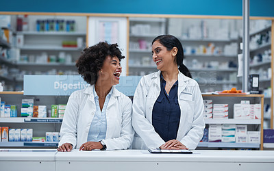 Buy stock photo Shot of two pharmacists working in a chemist
