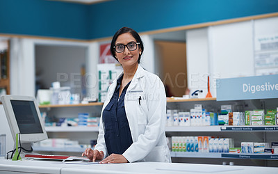 Buy stock photo Portrait of a mature pharmacist working on a digital tablet in a chemist