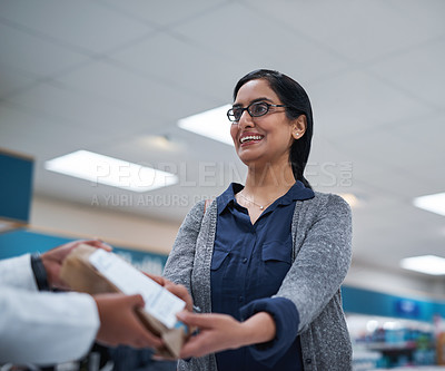 Buy stock photo Shot of a customer being assisted by a pharmacist in a chemist