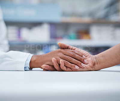 Buy stock photo Closeup shot of an unrecognizable pharmacist holding a customer's hand in comfort
