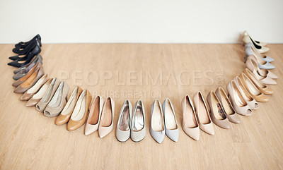 Buy stock photo High angle shot of a variety of high heels laid out on a wooden floor