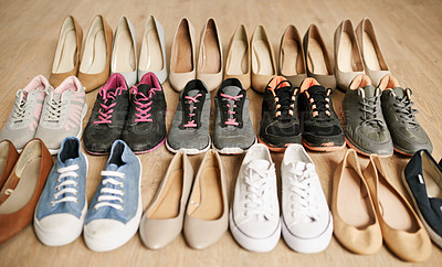 Buy stock photo High angle shot of a variety of footwear lined up on a wooden floor