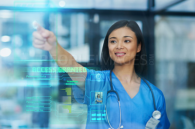 Buy stock photo Cropped shot of an attractive young female nurse using a touchscreen interface while standing in the hospital
