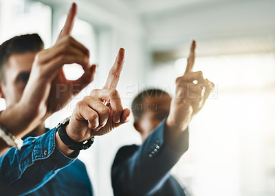 Buy stock photo Cropped shot of a group of businesspeople raising their hands in an office