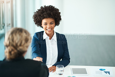 Buy stock photo Cropped shot of two people shaking hands in an office