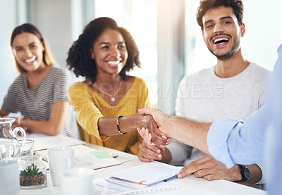 Buy stock photo Cropped shot of an attractive young businesswoman shaking hands with a colleague during a meeting in the boardroom