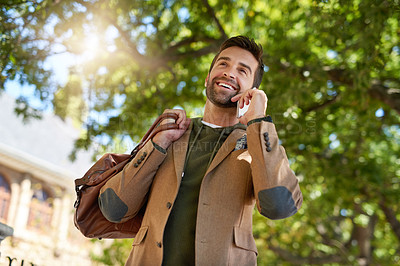 Buy stock photo Cropped shot of a handsome young man making a phonecall during his morning commute