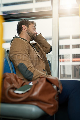 Buy stock photo Cropped shot of a handsome young man sleeping on the bus during his morning commute