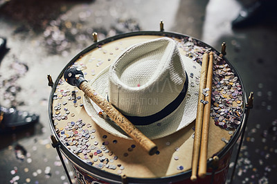 Buy stock photo Still life shot of a fedora and confetti on a drumset