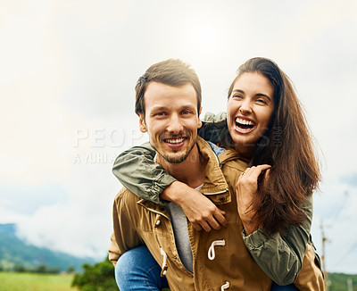 Buy stock photo Cropped shot of a playful couple spending the day outdoors