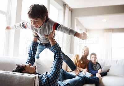 Buy stock photo Shot of a happy family having fun together at home