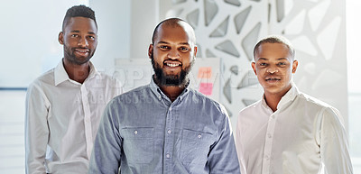 Buy stock photo Portrait of a group of businessmen standing together in an office