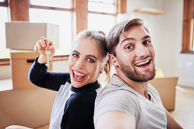 Buy stock photo Portrait of a happy young couple on moving day in their new home