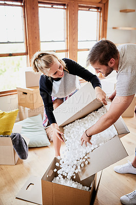 Buy stock photo Cropped shot of happy young couple on their moving day