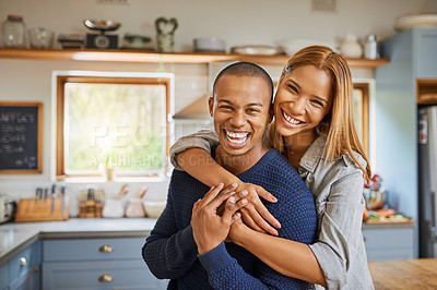 Buy stock photo Shot of a young couple spending the day at home