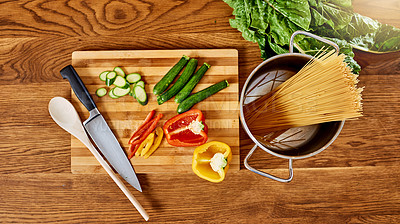 Buy stock photo Shot of raw ingredients on a wooden counter