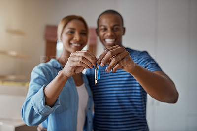 Buy stock photo Cropped shot of a young couple holding the keys to their new home