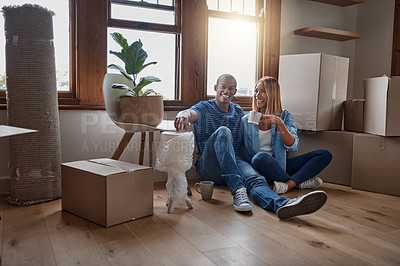Buy stock photo Shot of a couple taking a break from unpacking in their new home