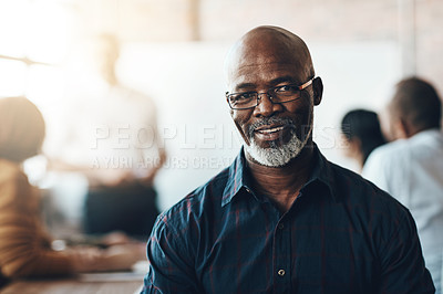 Buy stock photo Cropped portrait of a businessman sitting in the boardroom during a presentation