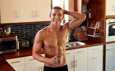 Buy stock photo Portrait of a handsome young shirtless man drinking a cup of coffee in the kitchen at home