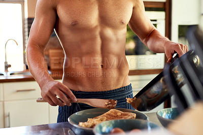 Buy stock photo Cropped shot of an unrecognizable man making breakfast in the kitchen at home