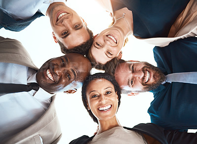 Buy stock photo Low angle portrait of a group of unrecognizable business colleagues standing with their hands in a huddle in their office