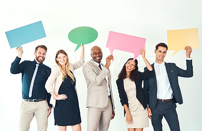 Buy stock photo Cropped portrait of a group of business colleagues holding up blank signs and placards while standing in their office