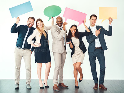Buy stock photo Full length portrait of a group of business colleagues holding up blank signs and placards while standing in their office