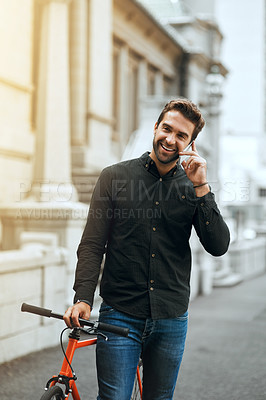 Buy stock photo Cropped shot of a handsome young man making a phonecall while traveling through the city