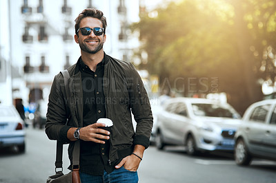 Buy stock photo Cropped shot of a handsome young man traveling through the city