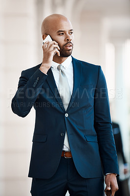 Buy stock photo Cropped shot of a handsome businessman on a call outside