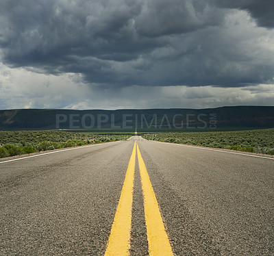 Buy stock photo Shot of an empty road in the countryside